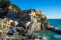Scenic view of Manarola village and the sea in Liguria region, Cinque Terre, northern Italy on clear day. Royalty Free Stock Photography