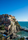 Scenic view of Manarola village and the sea in Liguria region, Cinque Terre, northern Italy on clear day. Stock Photos