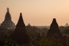 Temples and pagodas in Bagan at sunrise Stock Photos