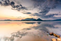 Scenic view at mirror of big lake in Sri Lanka during sunrise Royalty Free Stock Images
