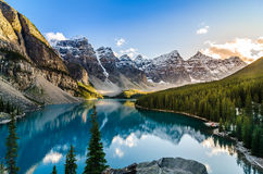 Scenic view of Moraine lake and mountain range at sunset. Landscape view of Moraine lake and mountain range at sunset in Canadian Rocky Mountains