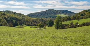 A Scenic View of a Mountain Farm. Floyd County, VA – October 20th: A mountain farm located in the Blue Ridge Mountains, Floyd County, Virginia, USA on stock image
