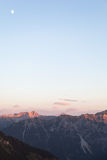 Scenic View of Mountain Panorama with Alpenglow in the Evening royalty free stock photography