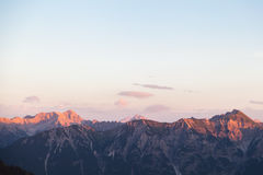 Scenic View of Mountain Panorama with Alpenglow in the Evening Royalty Free Stock Photo