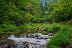 Scenic view of the mountain river in the north of Japan. Landscape view inside the mountain and a river in the forest near Ginzan Onsen village in Yamagata Stock Photo