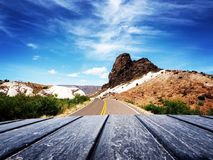 Scenic View of Mountain Road Against Blue Sky stock images