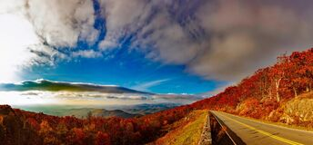 Scenic View of Mountain Road Against Cloudy Sky royalty free stock image