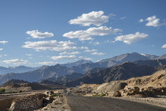 Scenic view of mountain road with majestic mountains Stock Image