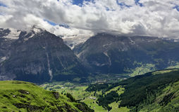 Summer view of mountain valley and ski resort, Grindelwald - Switzerland Royalty Free Stock Photo