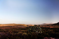 Scenic View of Mountain Valley at Sunset. Scenic View of South African Mountain Valley with Vegetation, Road and Farmland at Sunset or Sunrise with Big Blue Stock Images