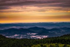 Scenic View of Mountains Against Cloudy Sky Royalty Free Stock Photography