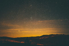 Scenic View of Mountains Against Sky at Night Stock Images