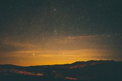 Scenic View of Mountains Against Sky at Night Royalty Free Stock Image