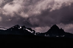 Scenic View of Mountains Against Storm Clouds Royalty Free Stock Image