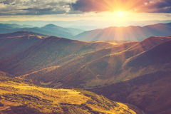 Scenic view of mountains, autumn landscape with colorful hills at sunset. Royalty Free Stock Image