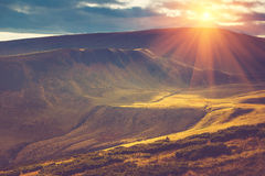 Scenic view of mountains, autumn landscape with colorful hills at sunset. Royalty Free Stock Photos
