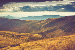 Scenic view of mountains, autumn landscape with colorful hills at sunset. Stock Photography