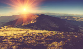 Scenic view of mountains, autumn landscape with colorful hills at sunset. Royalty Free Stock Photo
