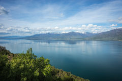 A scenic view of the mountains and Lake Prespa, Greece Royalty Free Stock Image