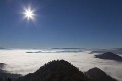 Scenic view from Mountains to foggy valleys Royalty Free Stock Photos