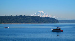 Scenic View of Mt. Rainier with Boats. Captured in the vicinity of Normandy Park Washington stock photography