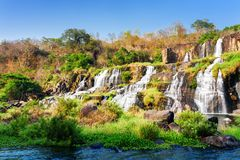 Scenic view of natural cascading waterfall in autumn stock photos