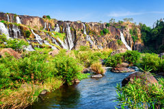 Scenic view of natural cascading waterfall with crystal clear wa Royalty Free Stock Photography
