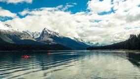 Mountain lake with 2 kayaks royalty free stock image