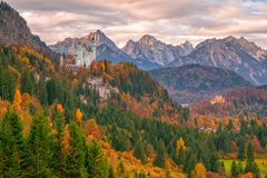 Scenic view of Neuschwanstein and Hohenschwangau castles at autumn morning stock photography