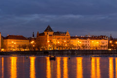 Scenic view in night of the Old Town architecture over Vltava river in Prague, Czech Republic Royalty Free Stock Photo