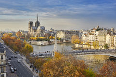 Scenic view of Notre-Dame de Paris on a bright fall day. Scenic view of Notre-Dame de Paris with Saint-Louis and Cite islands on a bright fall day stock images