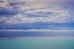 Scenic view of ocean and dramatic cloudscape Stock Image