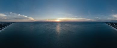 Scenic View of Ocean During Sunset Stock Photos