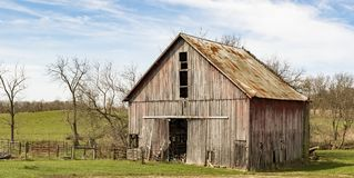 Scenic view of an old barn. A view of an old barn amidst a blue sky in early spring royalty free stock images