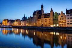 Long Bridge waterfront in Gdansk at dusk. Scenic view of old buildings along the Long Bridge waterfront and their reflections on the Motlawa river at the Main Royalty Free Stock Photo