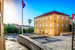 Town Supetar city center in Dallmatia, Croatia. Scenic view at old colorful square in city center of Supetar, popular tourist resort in Croatia, Island Brac stock photography