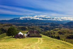Scenic view of an old house. On mountains background Royalty Free Stock Photography