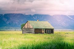 Scenic view of an old house on mountains background. Old house in mountains royalty free stock photo