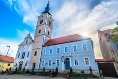 City center in Krizevci, Croatia. Scenic view at old landmark church in Krizevci town, Northern Croatia stock photo