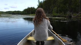 Paddling in a canoe on a peaceful lake