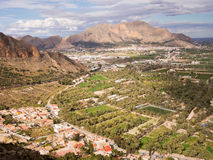 Sierra de Orihuela in Alicante, Spain. Scenic view of Orihuela town, mountains, palm garden and agricultural landscape in the province of Alicante, Spain Royalty Free Stock Images