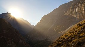 Scenic view over the Colca Canyon, Peru. Sun rising up over the hill stock photography