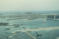 Scenic view over Dubai Marina harbor with boats and yachts. Royalty Free Stock Images