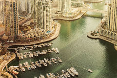 Scenic view over Dubai Marina harbor with boats and yachts. Stock Image
