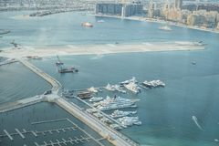 Scenic view over Dubai Marina harbor with boats and yachts. Stock Photography