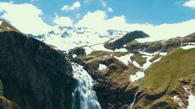 Scenic view over river with white water and distant mountain with high waterfall. View from the top of the waterfall and Royalty Free Stock Photography