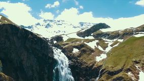 Scenic view over river with white water and distant mountain with high waterfall. View from the top of the waterfall and Stock Photography