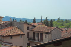 Scenic view over small italian village and hill side Stock Photography