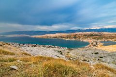 Scenic View Over Village On Pag Island In The Evening stock photos