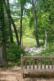 Scenic  View. Pastoral scene of flowers and trees and lake from with bench Stock Photography